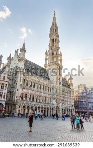 Brussels, Belgium - May 13, 2015: Many tourists visiting famous Grand Place (Grote Markt) the central square of Brussels. The square is the most memorable landmark in Brussels.