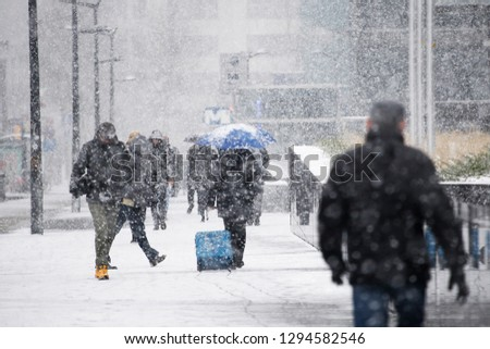 Brussels, Belgium. 22nd January 2019.People walk through a snow-covered streets during a heavy snowfall.  #1294582546