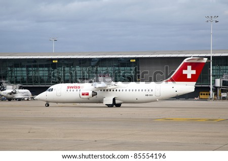 "BRUSSELS, BELGIUM - SEPT 17: A Swiss Air airplane lands at the airport in Brussels, Belgium on Sept. 17,  2011 in Brussels, Belgium. Swiss Airlines has been named ""Europe's Leading Airline Business Class"" of World Travel Awards"