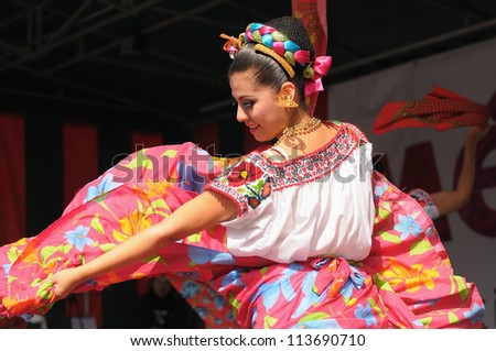 BRUSSELS BELGIUM-SEPTEMBER 15 Dancer of Xochicalli Mexican folkloric ballet performs in a concert on Grand Place during 12 edition of Folklorissimo Festival on September 15 2012 in Brussels