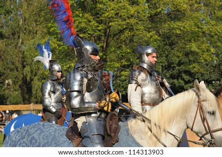 BRUSSELS, BELGIUM-SEPTEMBER 16: Unidentified performers do lap of honor after medieval tournament during 16th Edition of Medieval Celebration in Abbey de Forest on September 16, 2012 in Brussels.