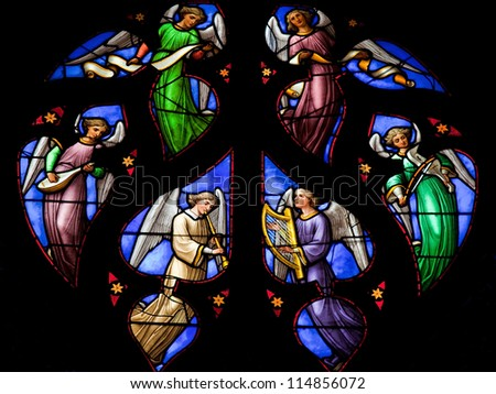 BRUSSELS - JULY 26: Stained glass window depicting an Angels choir, in the cathedral of Brussels on July, 26, 2012.