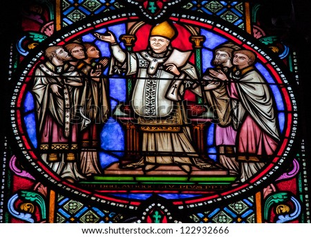 BRUSSELS - JULY 26: Stained glass window depicting Blessed Pope Pius IX (1792 - 1878), in the cathedral of Brussels on July, 26, 2012.