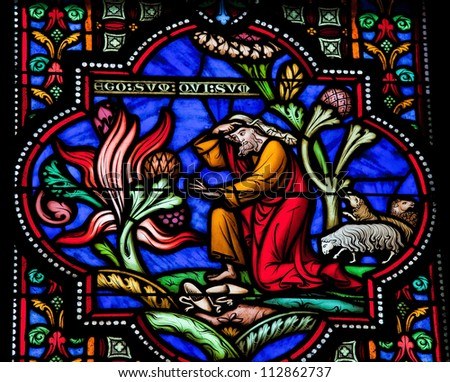 BRUSSELS - JULY 26: Stained glass window depicting Moses and the burning bush in the cathedral of Brussels on July, 26, 2012.