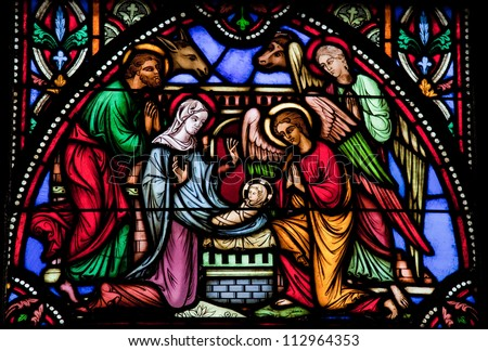 BRUSSELS - JULY 26: Stained glass window depicting Nativity Scene on Christmas in the cathedral of Brussels on July, 26, 2012.