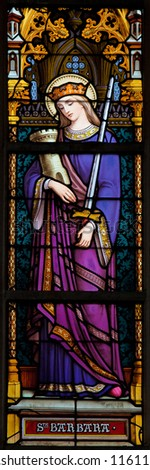 BRUSSELS - JULY 26: Stained glass window depicting Saint Barbara, in the cathedral of Brussels on July, 26, 2012.