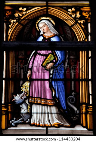 BRUSSELS - JULY 26: Stained glass window depicting Saint Gudula in the cathedral of Brussels on July, 26, 2012.