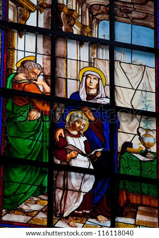 BRUSSELS - JULY 26: Stained glass window depicting the Holy Family, in the cathedral of Brussels on July, 26, 2012.