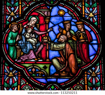 BRUSSELS - JULY 26: Stained glass window depicting the three kings from the East visit the Holy Family in Bethlehem, in the cathedral of Brussels on July, 26, 2012.