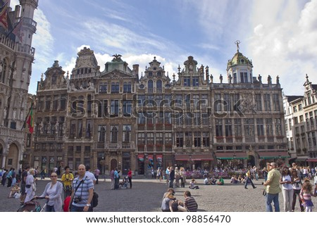 BRUSSELS - JULY 17: Walking tourists on July 17, 2010 at Grand Place, Brussels, Belgium. Grand Place was named by UNESCO as a World Heritage Site in 1998.