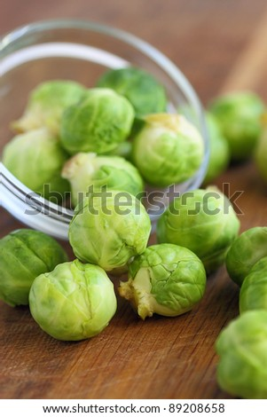 Brussels sprout in a glass bowl on wooden table