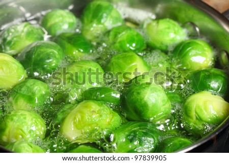 Brussels sprouts boiling in water.