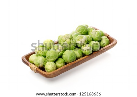 Brussels sprouts in a bowl closeup on a white background