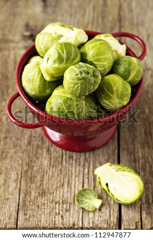 Brussels sprouts in a red colander