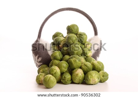 Brussels sprouts in a studio setting over white - stock photo