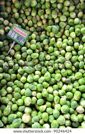 Brussels sprouts on a market stall with the price tag