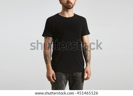 Shutterstock Brutal attractive bearded biker man with tattooed hands poses in black blank t-shirt from premium thin cotton, isolated on white mockup