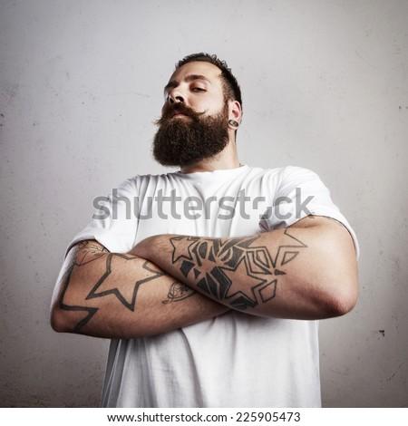 Brutal bearded man wearing white t-shirt