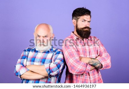 Brutal guys with long beard. Barbershop concept. Barber well groomed handsome bearded man. Bearded friends. Hairdresser salon. Father and son. Men bearded hipster stand back to back. Family team.
