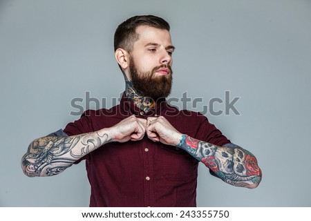 Brutal handsome man with tattooed body