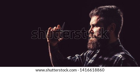 Brutal male, hipster with moustache. Male in barbershop, haircut, shaving. Mans haircut in barber shop. Profile of stylish beard man, scissors. Barber scissors, barber shop. Copy space.