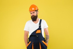 Brutal man builder. Engineer builder in uniform. Man builder hard hat. Renovating home opportunity to refresh expand and renew. Craftsman keep head safe in helmet. Building improvement and renovation.