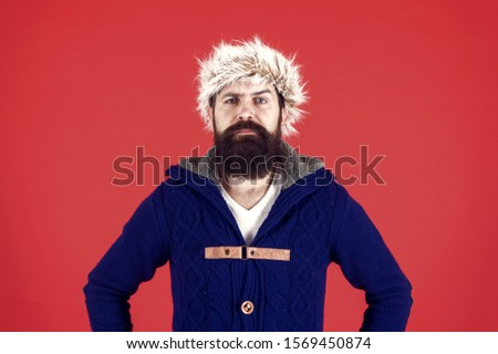 brutal man earflap hat. fur hat accessory. bearded man ready for winter activity. get warm and comfortable. male fashion. serious trendy hipster. beard care in cold season. cold season depression. #1569450874