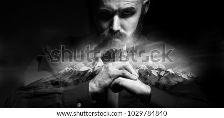 brutal portrait of a man fists force, unusual daring portrait aggressive man, beard, fists, hands, concept masculine strength Foto stock ©