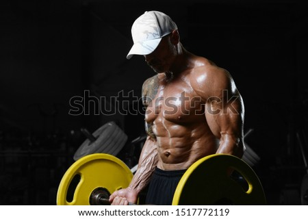 Brutal strong athletic men pumping up muscles workout bodybuilding concept background - muscular bodybuilder handsome men doing exercises in gym naked torso