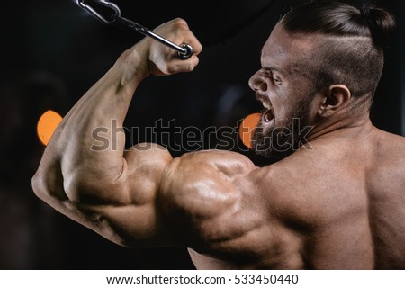 Brutal strong athletic men pumping up muscles workout bodybuilding concept background - muscular bodybuilder handsome men doing exercises in gym naked torso fitness and bodybuilding