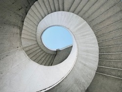 Brutalist spiral staircase with a view of the sky located in Warsaw, Poland