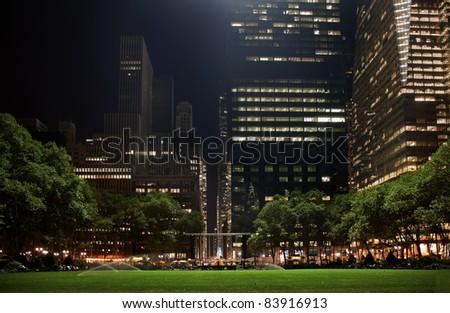 Bryant Park New York City Green Grass Skyline Apartment Buildings Night