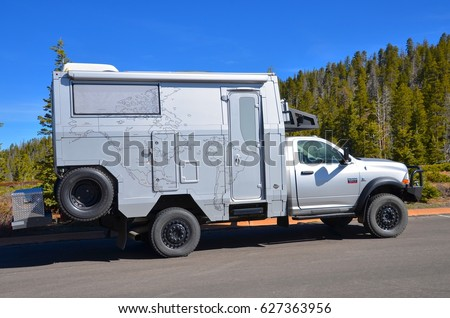 Bryce Canyon, Utah - April 22: RV Truck at Bryce Canyon National Park, Utah on April 22, 2017. Silver Unique RV Truck with World Map Print  #627363956