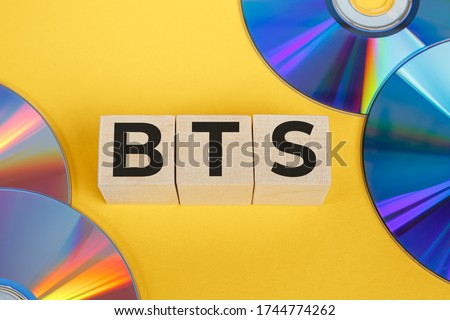 BTS concept with wooden cubes. BTS word on CD background Stock fotó ©