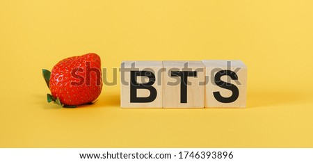 BTS concept with wooden cubes. The word BTS on a yellow background Stock fotó ©