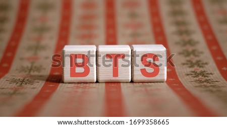BTS - financial business concept. Wooden cubes on a color table. Stock fotó ©