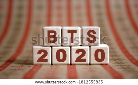 BTS 2020 text on wooden cubes on a monochrome background with reflection. Stock fotó ©