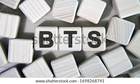 BTS text on wooden square cubes surrounded by other cubes Stock fotó ©