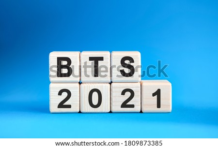 BTS 2021 years on wooden cubes on a blue background Stock fotó ©