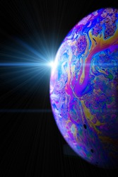 Bubble color. Globe planet earth in galaxy universe space with abstract sun on black background. Color abstract fluorescent inks in water