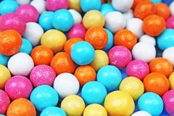Bubble gum chewing gum texture. Rainbow multicolored gumballs chewing gums as background. Round sugar coated candy bonbon bubblegum texture. Colorful multicolor bubblegums wallpaper. Candy background