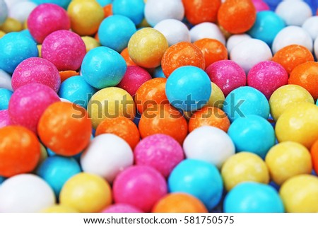 Bubble gum chewing gum texture. Rainbow multicolored gumballs chewing gums as background. Round sugar coated candy bonbon bubblegum texture. Colorful multicolor bubblegums wallpaper. Candy background #581750575