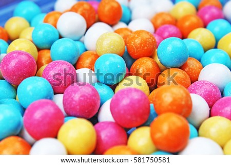 Bubble gum chewing gum texture. Rainbow multicolored gumballs chewing gums as background. Round sugar coated candy bonbon bubblegum texture. Colorful multicolor bubblegums wallpaper. Candy background #581750581