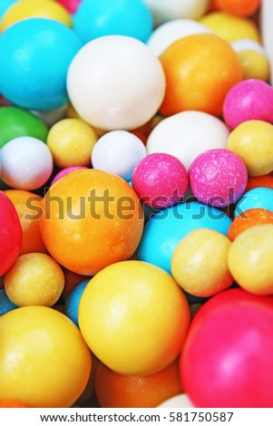 Bubble gum chewing gum texture. Rainbow multicolored gumballs chewing gums as background. Round sugar coated candy bonbon bubblegum texture. Colorful multicolor bubblegums wallpaper. Candy background #581750587