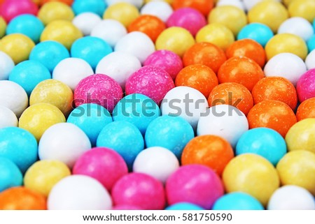 Bubble gum chewing gum texture. Rainbow multicolored gumballs chewing gums as background. Round sugar coated candy bonbon bubblegum texture. Colorful multicolor bubblegums wallpaper. Candy background #581750590