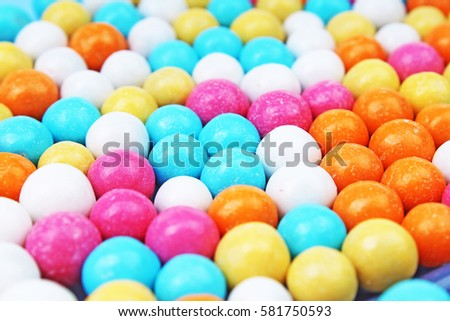 Bubble gum chewing gum texture. Rainbow multicolored gumballs chewing gums as background. Round sugar coated candy bonbon bubblegum texture. Colorful multicolor bubblegums wallpaper. Candy background #581750593