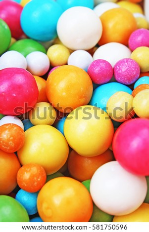 Bubble gum chewing gum texture. Rainbow multicolored gumballs chewing gums as background. Round sugar coated candy bonbon bubblegum texture. Colorful multicolor bubblegums wallpaper. Candy background #581750596