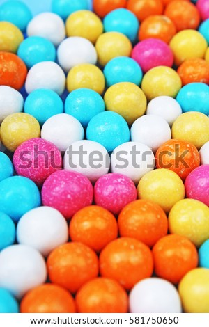 Bubble gum chewing gum texture. Rainbow multicolored gumballs chewing gums as background. Round sugar coated candy bonbon bubblegum texture. Colorful multicolor bubblegums wallpaper. Candy background #581750650