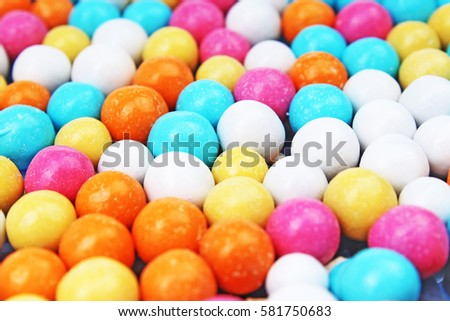 Bubble gum chewing gum texture. Rainbow multicolored gumballs chewing gums as background. Round sugar coated candy bonbon bubblegum texture. Colorful multicolor bubblegums wallpaper. Candy background #581750683