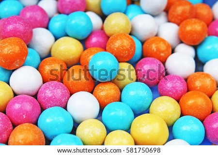 Bubble gum chewing gum texture. Rainbow multicolored gumballs chewing gums as background. Round sugar coated candy bonbon bubblegum texture. Colorful multicolor bubblegums wallpaper. Candy background #581750698